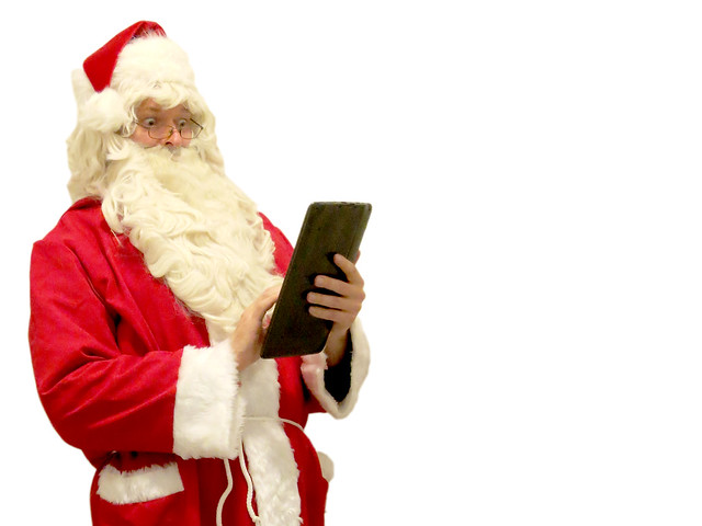 Santa Claus tapping a tablet
