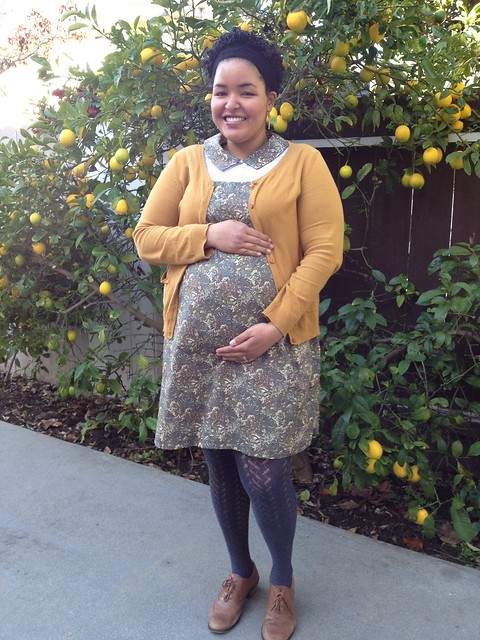 31 weeks and standing in front of our neighbor's lemon tree.