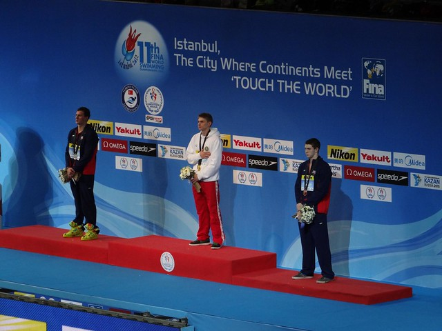 The Istanbul 2012 men's 200 back medal podium