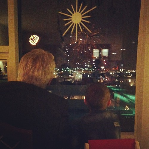 Grandfather and nephew watching the fireworks