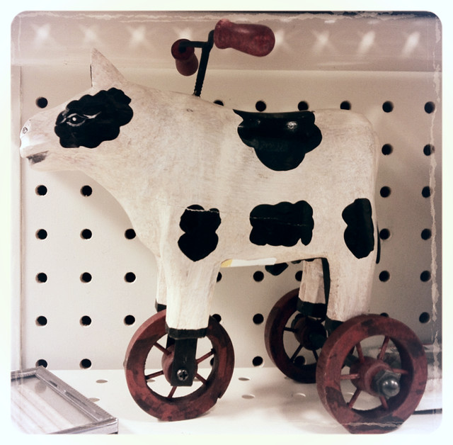 Cow-Cycle on shelf at Goodwill store.