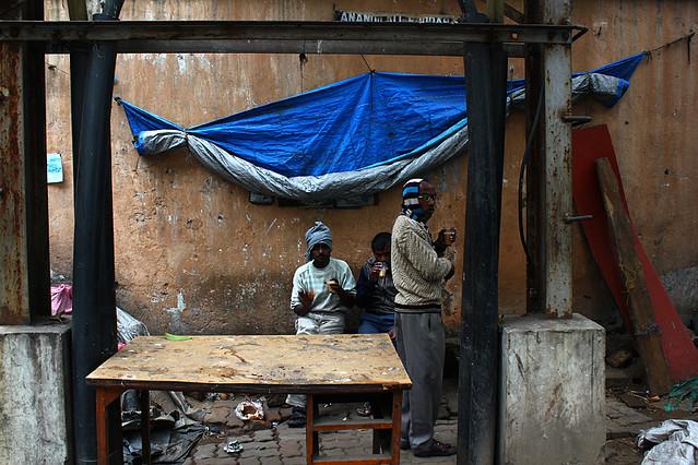 People drink chai tea on the street