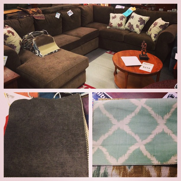 We're getting a new sofa! L-shape sectional with a chaise in dark grey and turquoise patterned pillows.