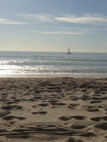 sailboat in ocean and beach
