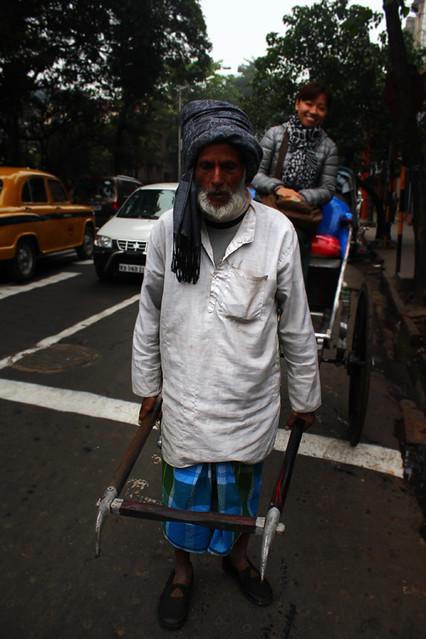 A human horse pulling his rickshaw