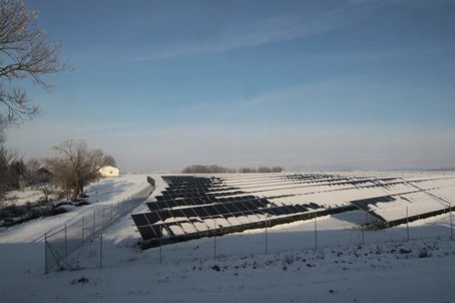 German countryside and a solar farm covered with snow