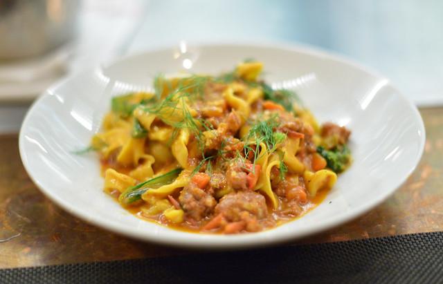 Tagliatelle allo Zafferano hand-cut saffron pasta, calabrian sausage ragu with cherry tomatoes, young rapini