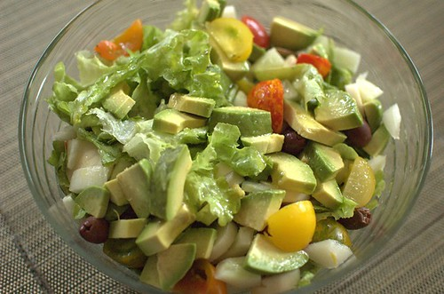 Salad with heirloom tomatoes, palmitos, avocado and olives