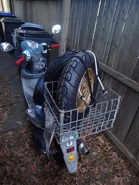 Buddy scooter hauling home Bridgestone Molas tires on the '86 Honda Elite wheels