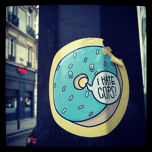 """"""" i hate cops """" says mr. Doughnut and I totally agree. #doughnuts #streetart #brussels #sticker"""