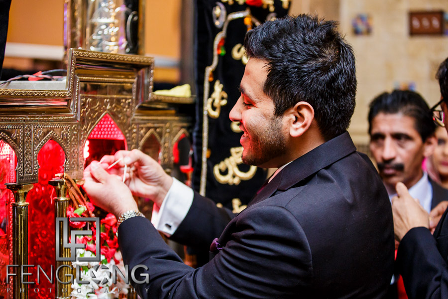 Groom at Muslim Indian wedding performing ritual