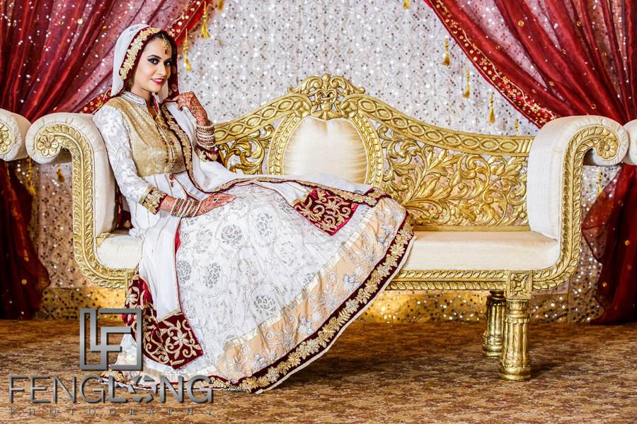 Muslim Indian bride on couch posing for formal portrait
