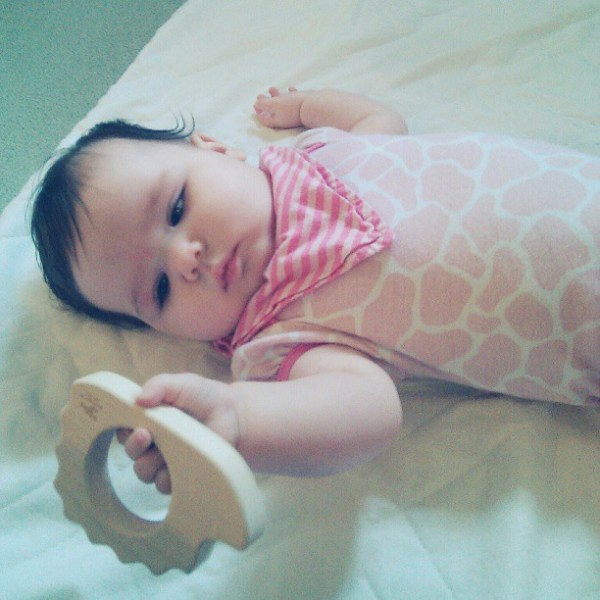 Gwen eying her new hedgehog teether from @littlesaplings #littlesaplingtoys #tinybuttonsblog