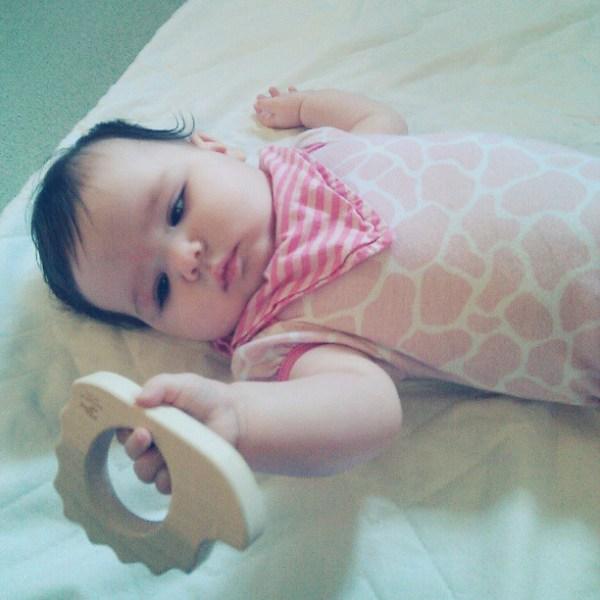 Gwen eying her new hedgehog teether from @littlesaplings #littlesaplingtoys #tinybuttonsblog