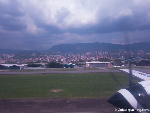 Landing at OH Airport, Poblado can be seen to the east (right)