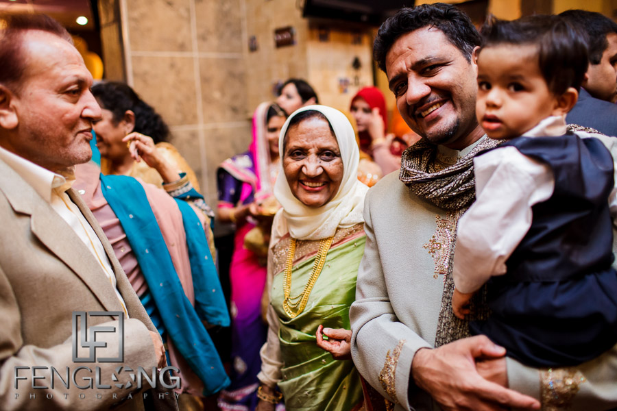 Elderly Indian woman in Hijab with child at wedding