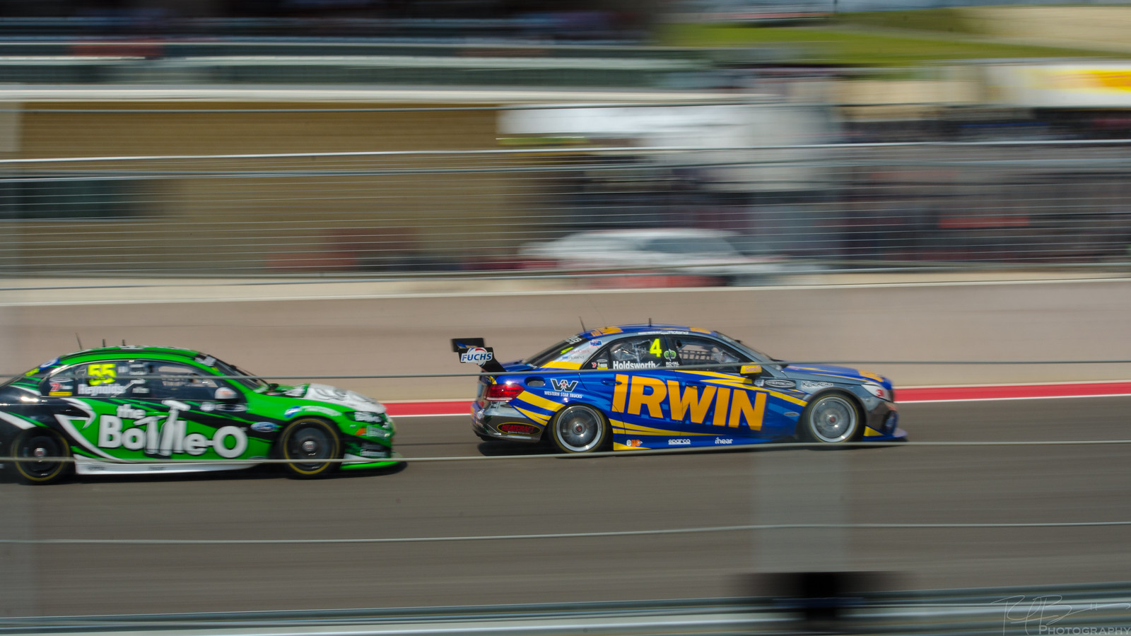 Lee Holdsworth in the AMG E63 leading David Reynolds in the Ford Falcon