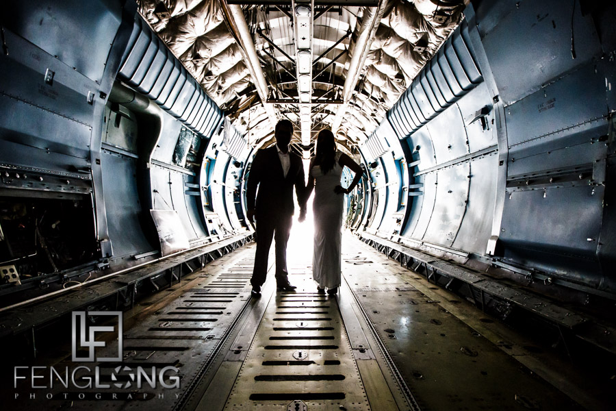 Silhouette of Indian bride and groom inside cargo plane for unique pre-wedding photos