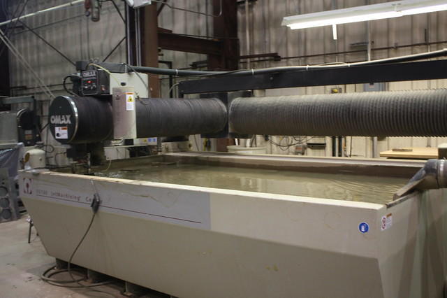 Water Jet Cutter-this machine is using water with a fine grit to cut precision metal