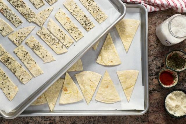 flour tortilla chips on baking sheets