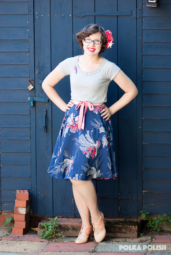 Trashy Diva Trixie halter dress in Deep Sea Coral being worn as a skirt with a grey-blue t-shirt and coral accessories