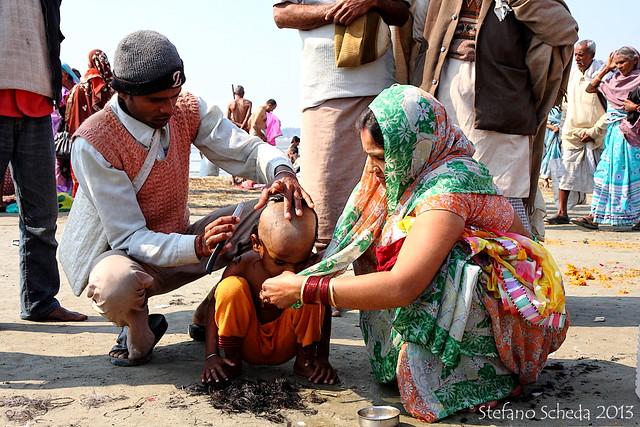 Ritual child haircut - Kumbh Mela, Allahabad, India