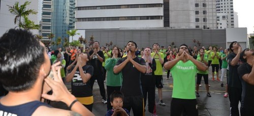 Participants exercising to Herbalife Fit Total Body workout video featuring Samantha Clayton