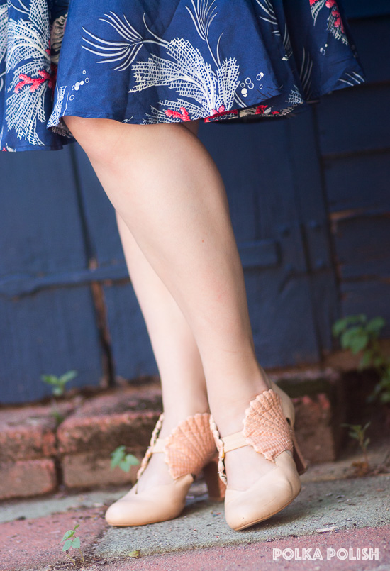 Miss L Fire shoes in pale peach feature a faux reptile textured seashell at each side of the foot