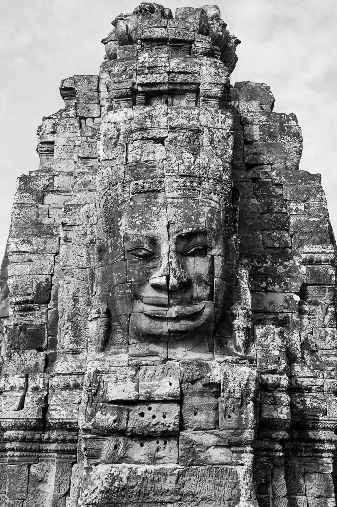 Smiling stone sculpture