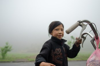 Girl with bike in the Mist