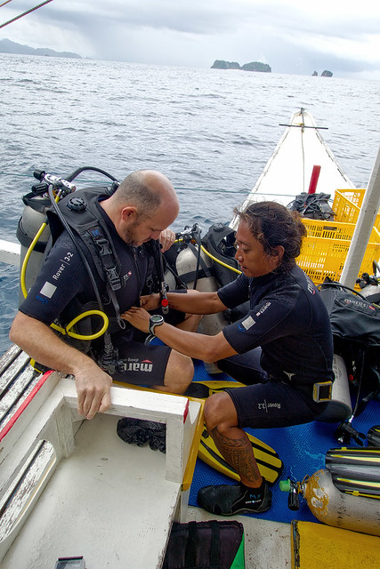 Matt suiting up with the help of Divemaster Joel.