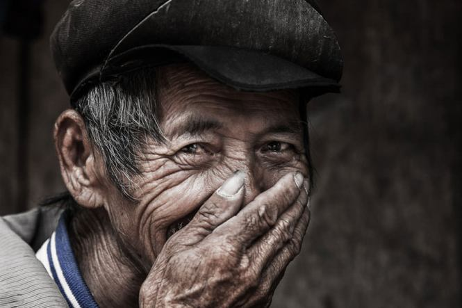 old-man-hidden-smile-portrait