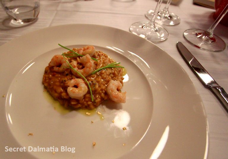 Shrimp risotto with edible 24 karat gold