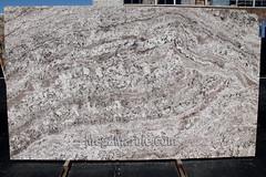 White Torroncino granite slab