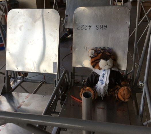 Hobbes sitting in an airplane seat