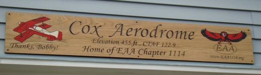 The sign over the door to the main hanger at Cox Airfield