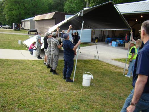 Lt. Morris leads cadets in setting up the food tents