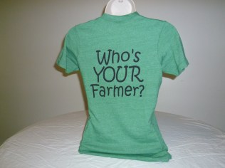 "Who's YOUR Farmer t-shirt, super soft, unisex sizes, available in Eco Green (pictured), Eco-Grey, and Eco-Navy. Front says ""Farmers are Cool"" small on left chest, back says ""Who's YOUR Farmer"". $25. 50% Polyester (6.25% recycled), Cotton 38% (6.25% organic), 12% rayon"