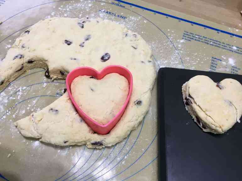 Cutting out heart shaped Cranberry Orange Scones