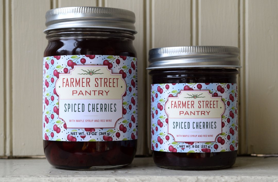 Spiced cherries in small and large jars