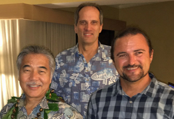 Hawaii Governor David Ige, Albert Perez, and Simon Russell