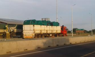 A truck load filled with fencing, pipes and Jo-Jo tanks heading for Toro Ranch