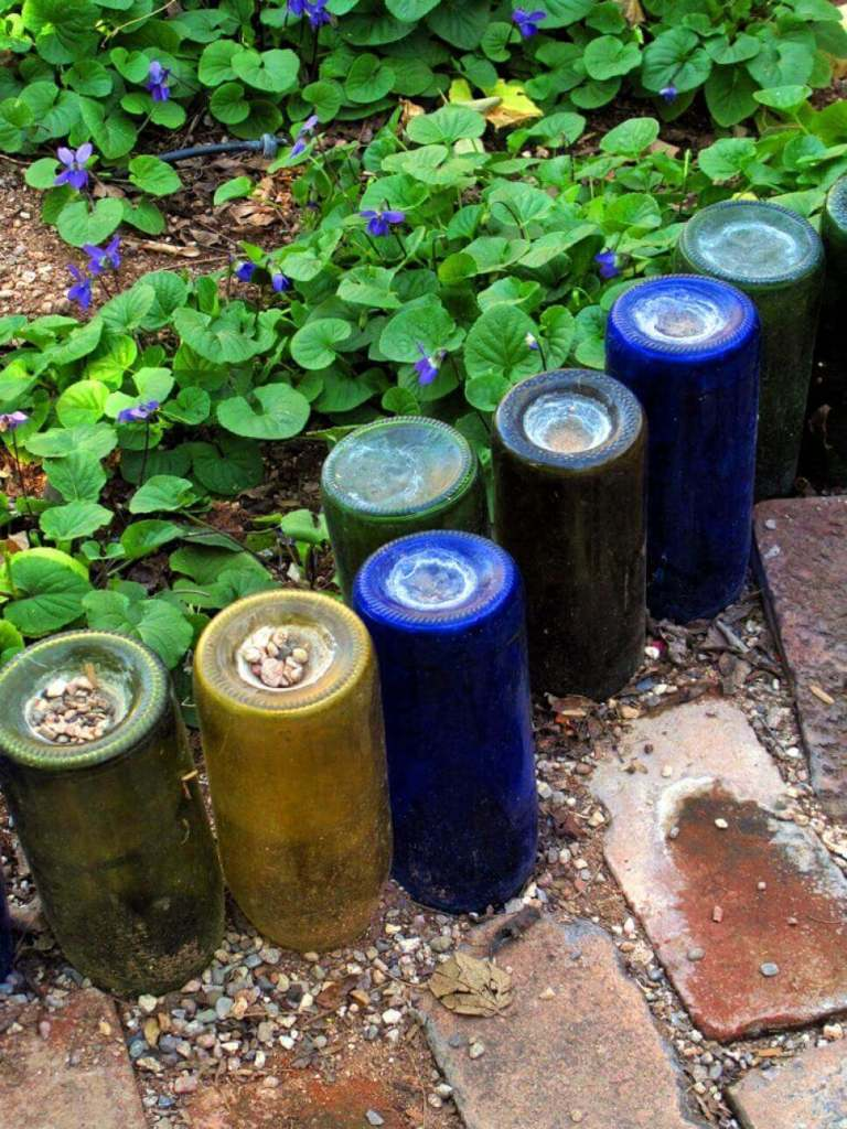 DIY Lawn Edging Ideas For Beautiful Landscaping: Creative Upside-down Colorful Wine Bottle Edge