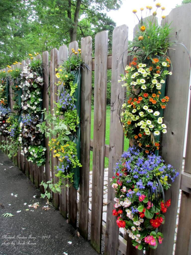 Overflowing Blossoms in Fence Hanging Planters
