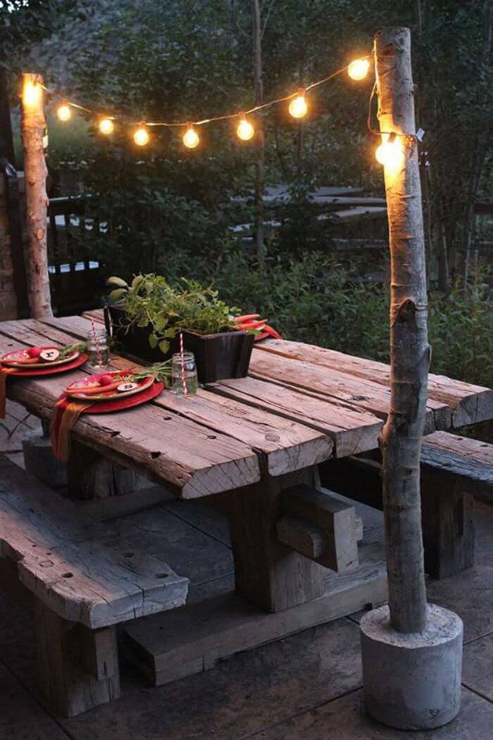 Earthy Picnic Table and Hanging Lights