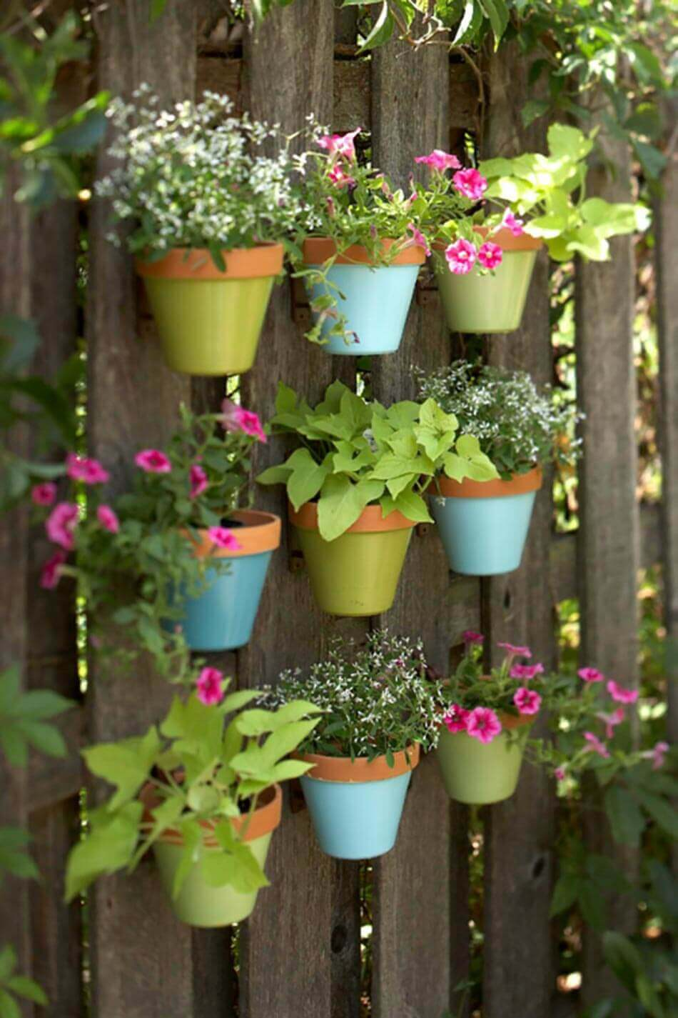 Garden Fence Decoration Idea with Wall Planters