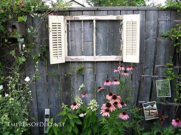 Upcycled Shuttered Window Frame on the Fence