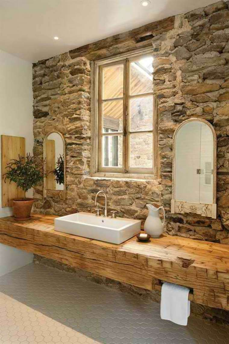 Rough Stone Accent Wall With Solid Beam Vanity