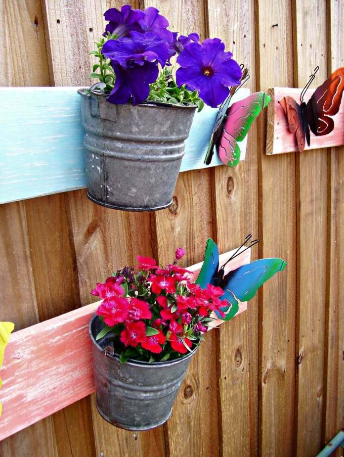 Bright Painted Butterflies on a Board with Pails