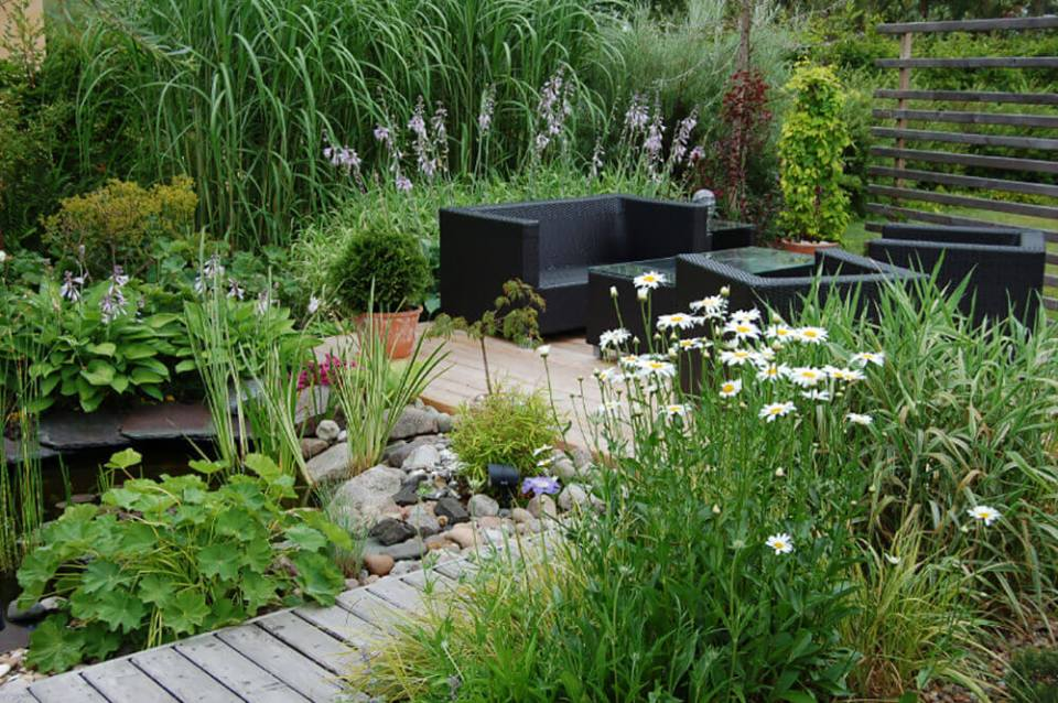 Black wicker furniture in this beautiful garden